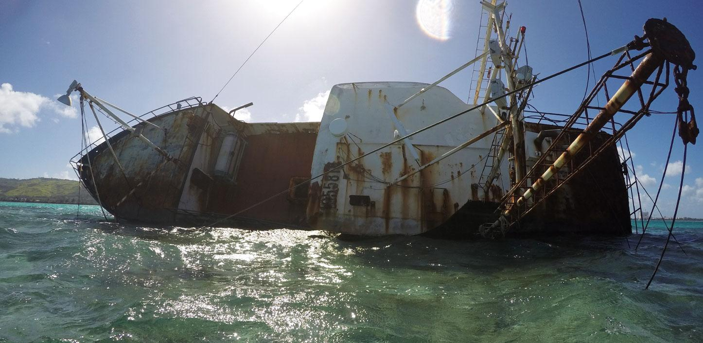 Derelict vessel on coral reef